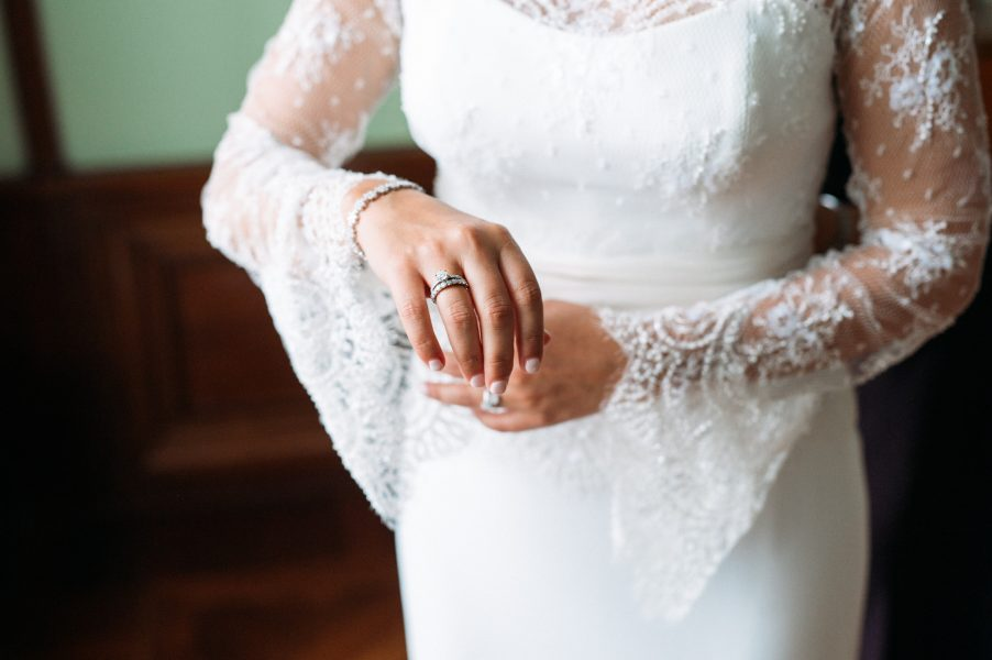 Close up of Bride's scallop sleeved wedding dress and ring at Sølyst Copenhagen København