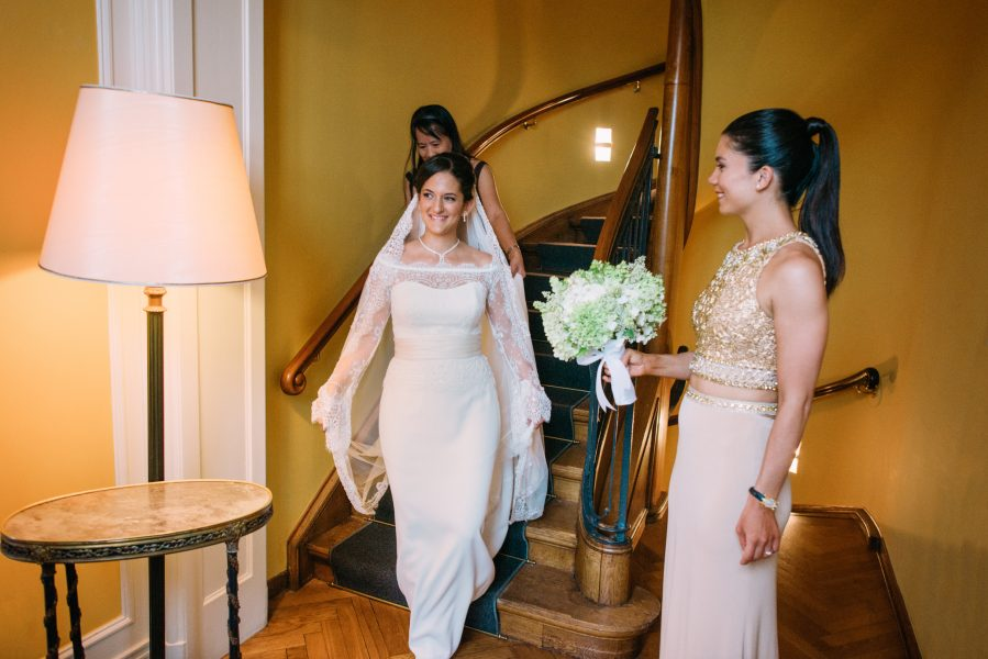 Bride walking down staircase at Sølyst Copenhagen to meet her Groom for the pre ceremony first look