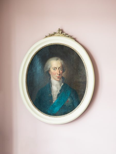 Oval historic painting on pink wall at Sølyst Copenhagen