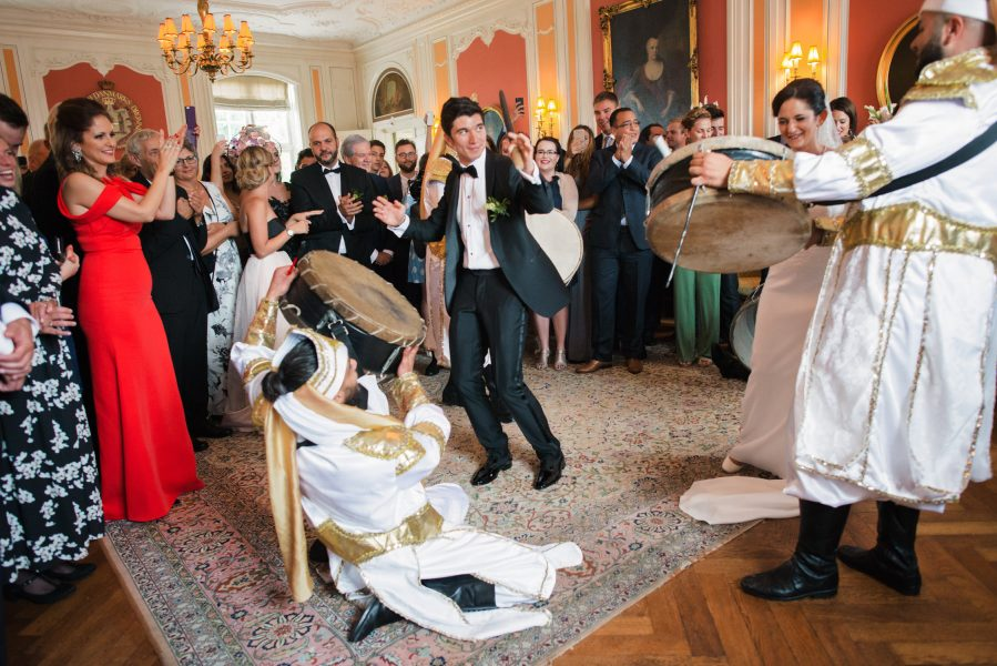 Zaffe drummers play drums down aisle with happy Groom beating drum Sølyst Copenhagen