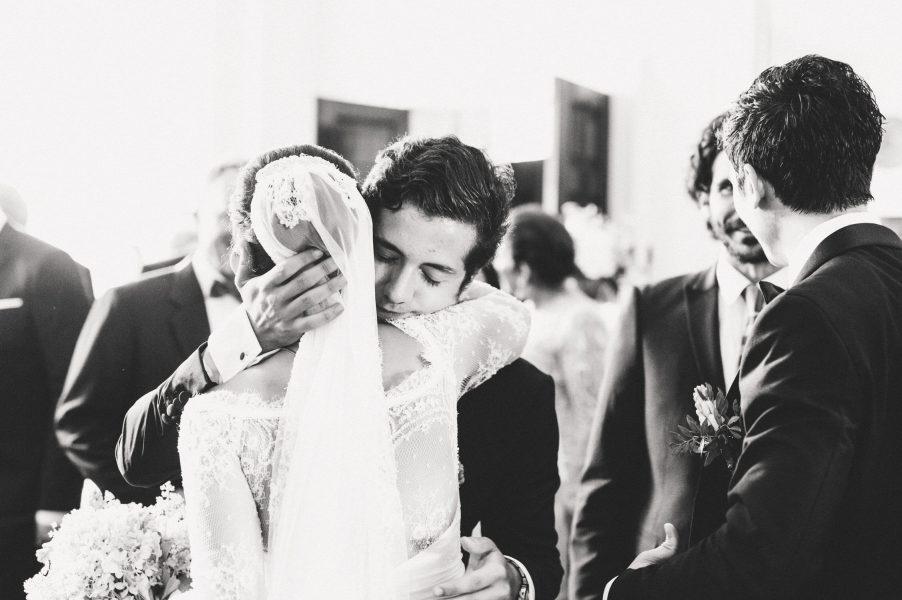Guest hugs bride Sølyst Copenhagen