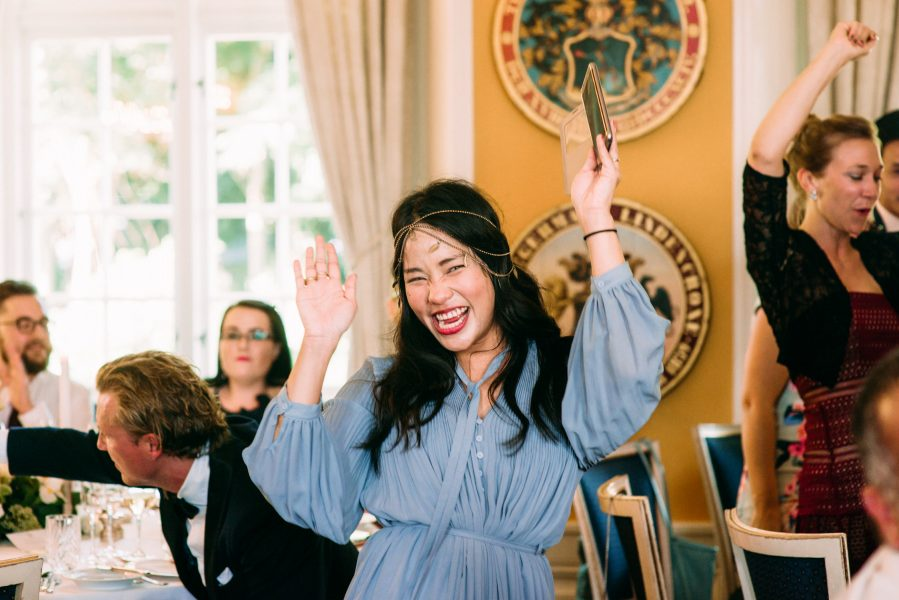 Happy wedding guest cheering Sølyst Copenhagen