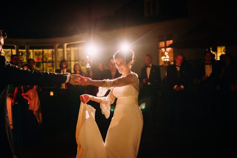 Dramatic first dance moment as Bride extends arm away gazing at Groom at Solyst Copenhagen