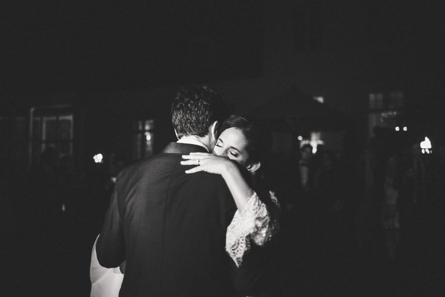 Classic black and white photo of Bride emotionally enjoying first dance at Solyst Copenhagen surrounds by torches