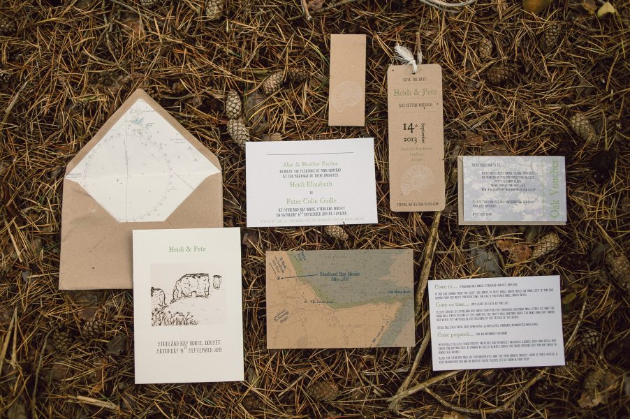 Wedding invitation and paper collage on rustic pine needles Studland Bay Dorset