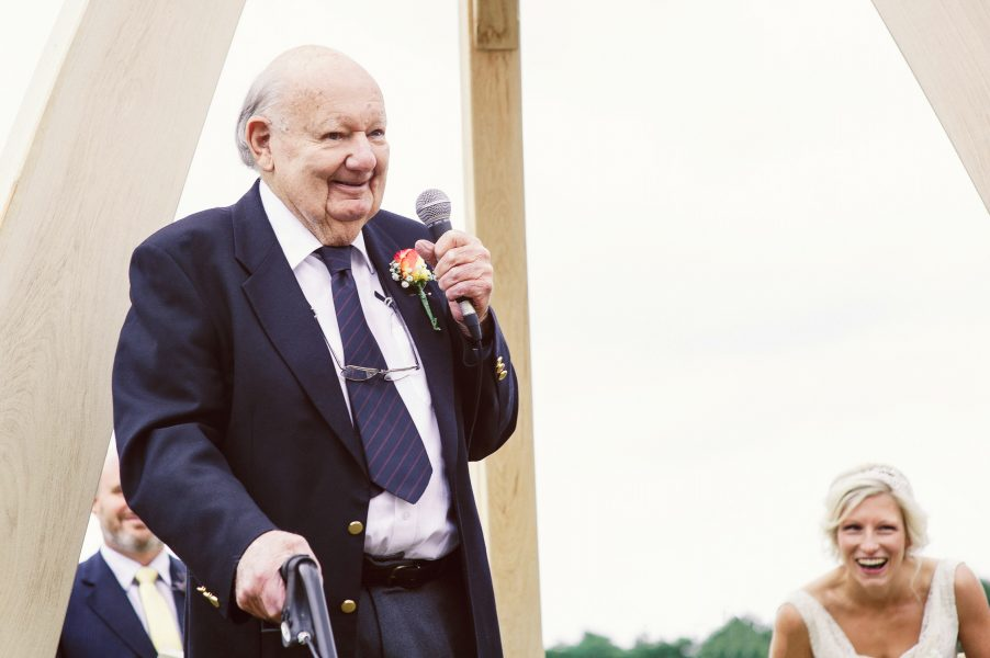 Grandfather of Bride gives arcading during the outdoor ceremony Studland Bay Dorset