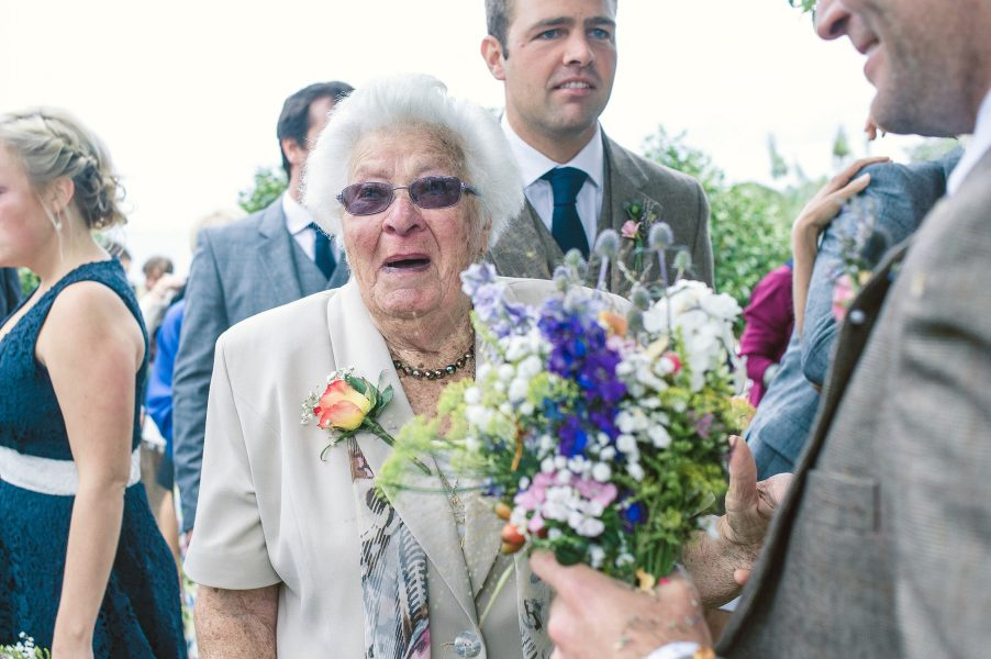 Happy Granny in a post wedding ceremony moment of excitement Studland Bay Dorset