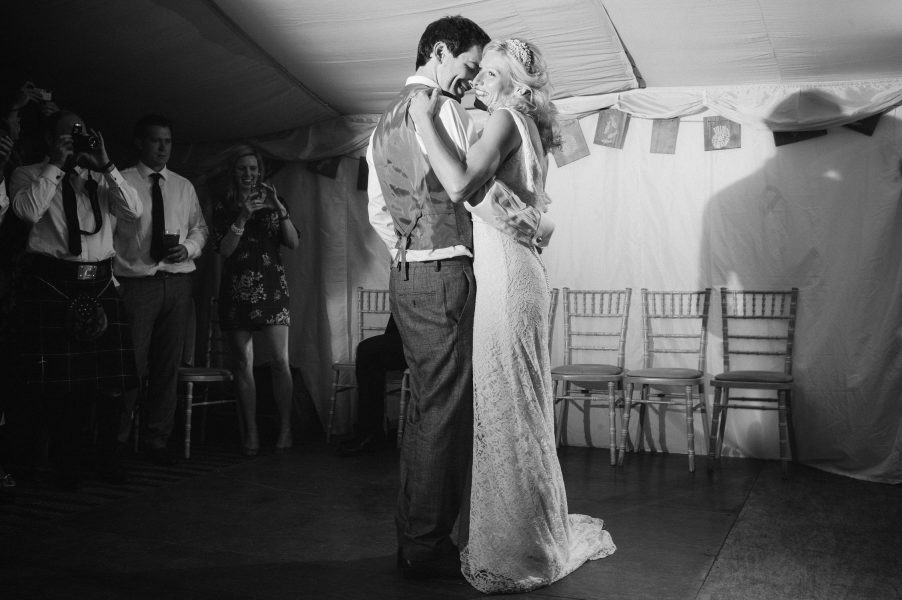 Bride and Groom in a romantic full length first dance moment
