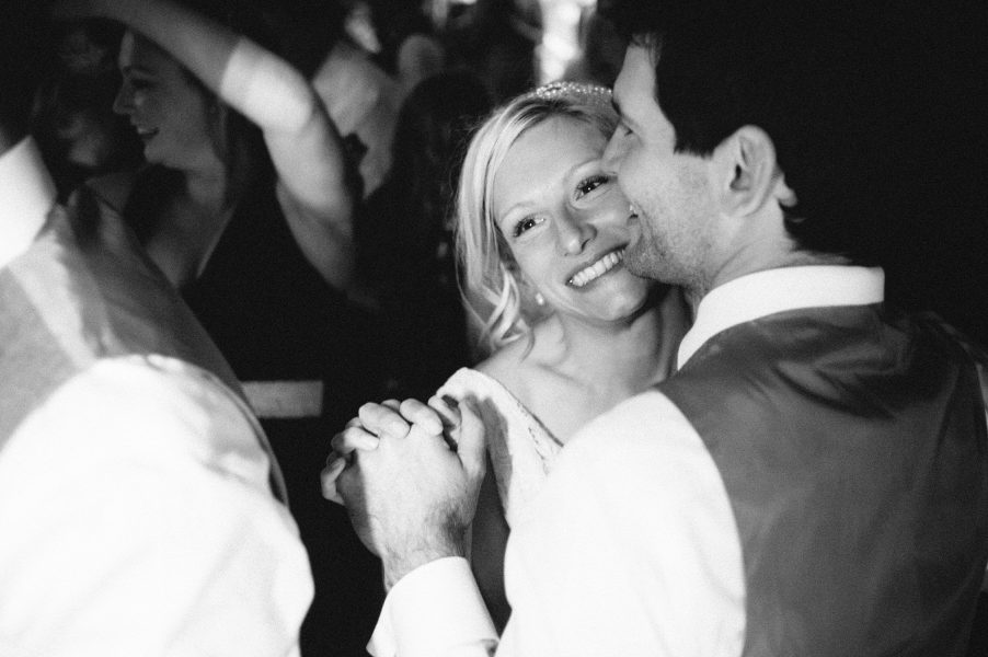Close up of Bride smiling on dance floor while dancing with Groom Studland Bay Dorset