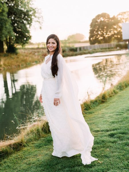 Boho bride portrait with long hair down in front of beautiful lake