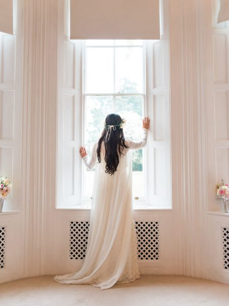 Dreamy Fine Art bride looking out of window Weston on the Green Oxfordshire