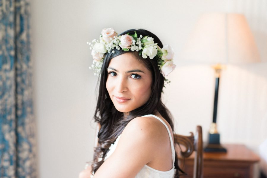 Portrait of a luxe boho Bride wearing blush rose floral crown by Fabulous Flowers