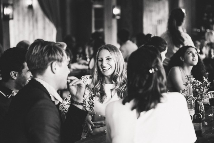 Guests having fun at table at Soho Farmhouse wedding Oxfordshire