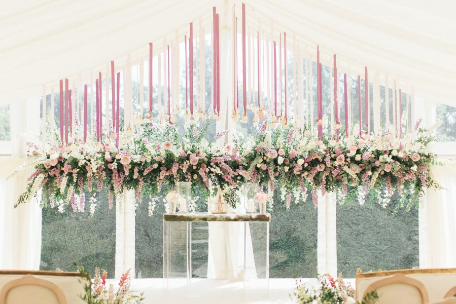 Stunning pastel flower display backdrop and suspended roses on pink and lavender ribbons by Fabulous Flowers Weston on the Green Oxforshire