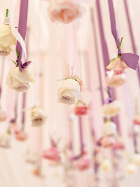 Suspended roses on pink and lavender ribbons by Fabulous Flowers Weston in the Green Oxforshire