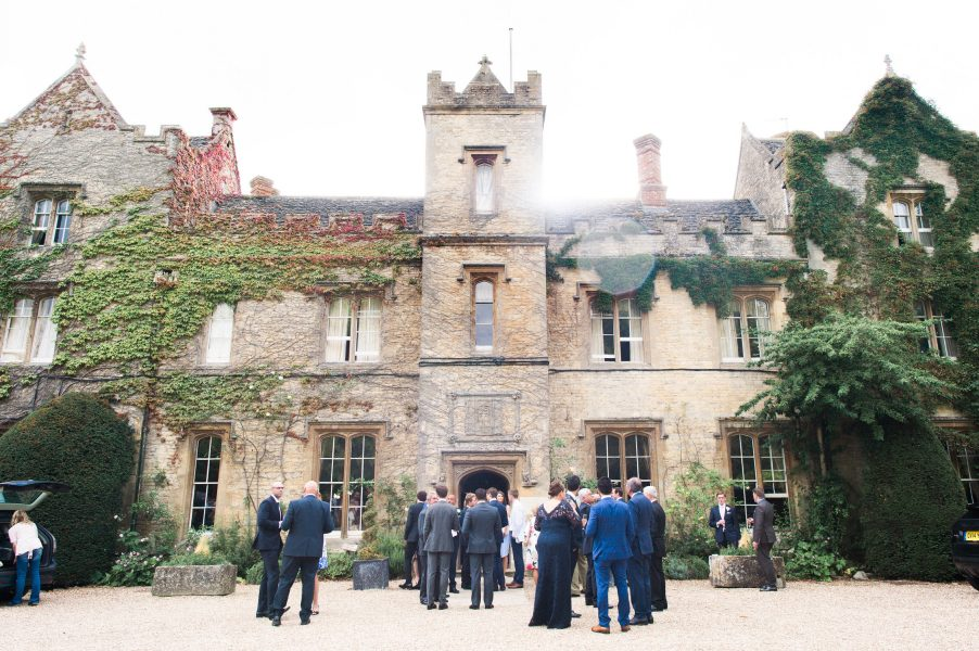 Guests gather in courtyard during drinks reception at Weston on Green Oxfordshire