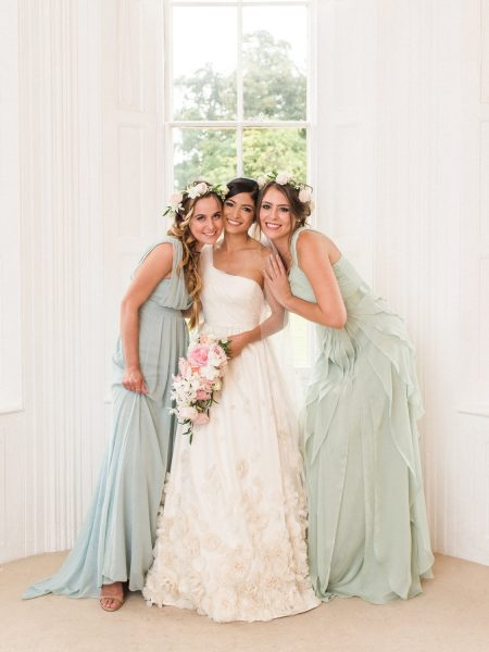 Bride with two bridesmaids in front of window at Weston on the Green Oxfordshire