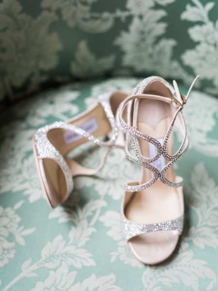 Jimmy Choo wedding shoes on an aqua green damask chair