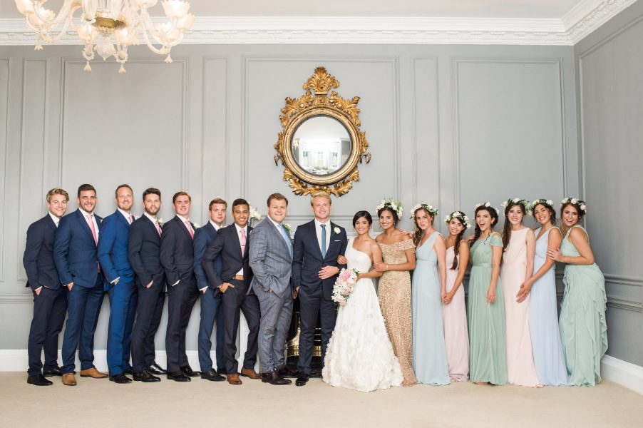 Bride and Groom with Bridal party portrait under a circular mirror Weston on the Green Oxforshire